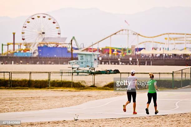 Two women running on Santa Monica beach