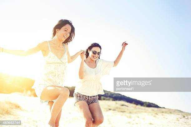 Two women running on the beach