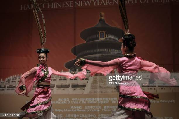 Two women seen performing the traditional chinese dance during the 'Chinese New Year Night of Beijing' event The Beijing National Orchestra holds the...