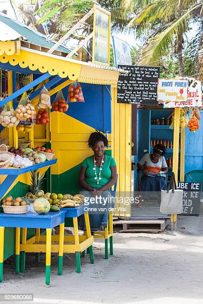 Two women selling fresh local fruits & vegetables in the Grenadines.