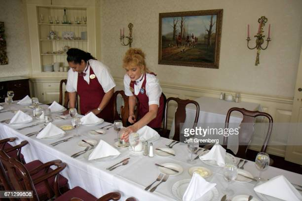 Two women setting the table at Montague Inn bed and breakfast