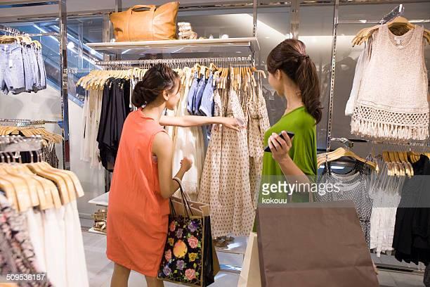 Two women shopping in clothing shop