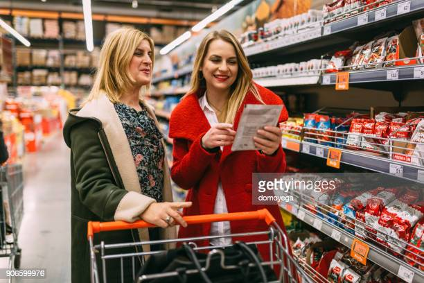 Two women shopping in the supermarket
