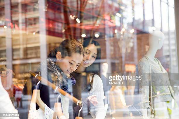 two women shopping together in the store