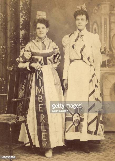 Two women show their support for the British during the Boer War circa 1899 Both wear Union Jacks incorporated into their clothing and while one's...