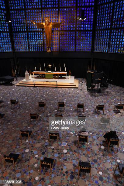 Two women sit among chairs that stand socially-distanced prior to an evening service at the Kaiser Wilhelm Memorial Church during the second wave of...