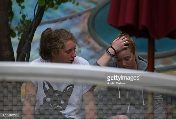 Two women sit in front of an apartment building where a balcony collapsed near UC Berkeley on June 16, 2015 in Berkeley, California. 5 people were...