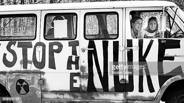Two women sit in the van used as mobile headquarters by the Clamshell Alliance an antinuclear organization to protest the Seabrook NH nuclear plant...