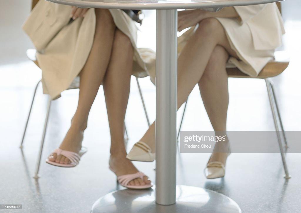 Legs Under Table High Res Stock
