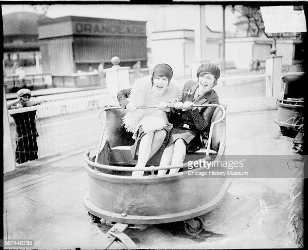 Two women sitting in a car on a ride at the White City amusement park located at 63rd and South Parkway in the Englewood community area Chicago...