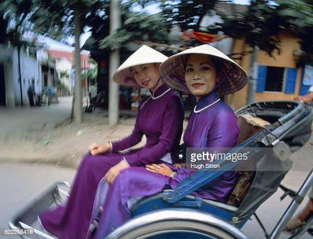 two women sitting in a ricksha - hugh sitton stock pictures, royalty-free photos & images