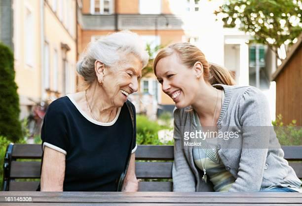 Two women sitting outside