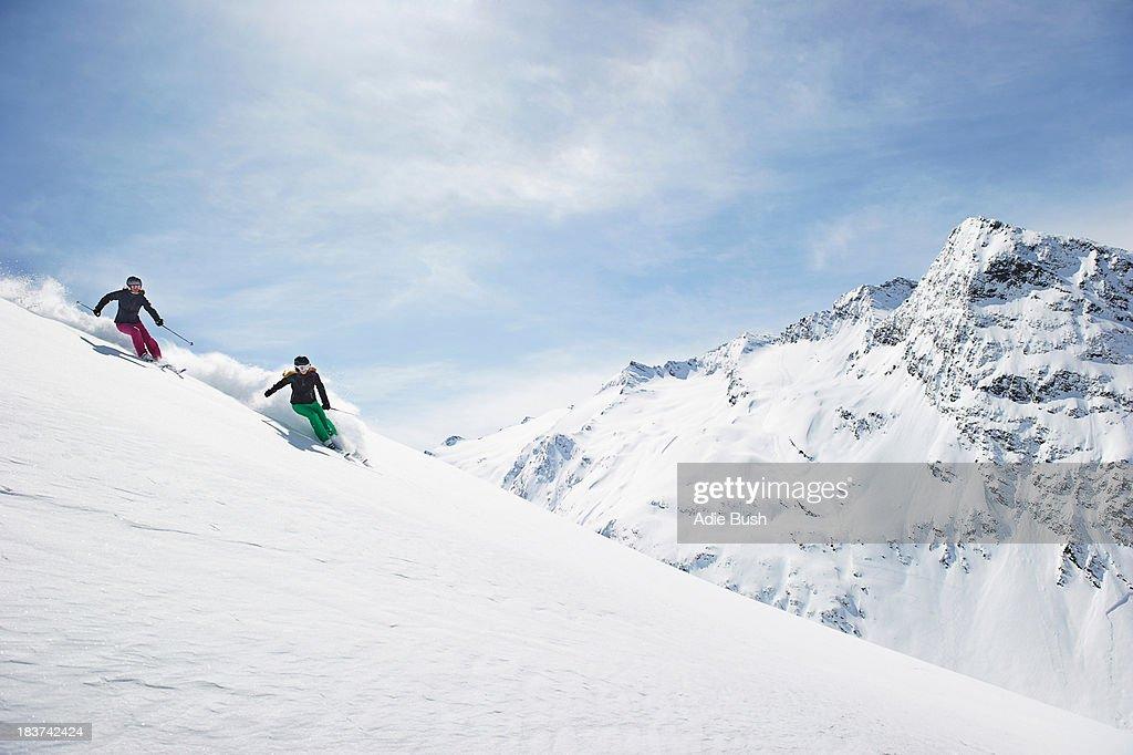 Two women skiing : Stock Photo