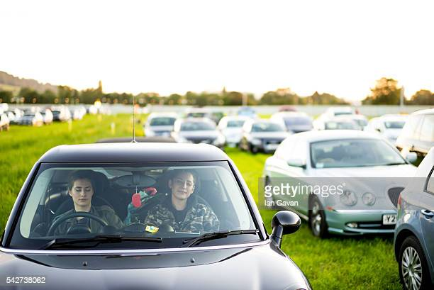 Two Women sleep in their car at the Glastonbury Festival at Worthy Farm Pilton on June 23 2016 in Glastonbury England Now in its 46th year the...