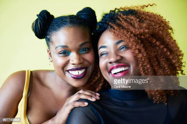 two women smiling looking to camera - black sexual stock photos and pictures
