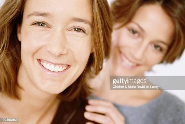 Two women smiling, portrait, close-up
