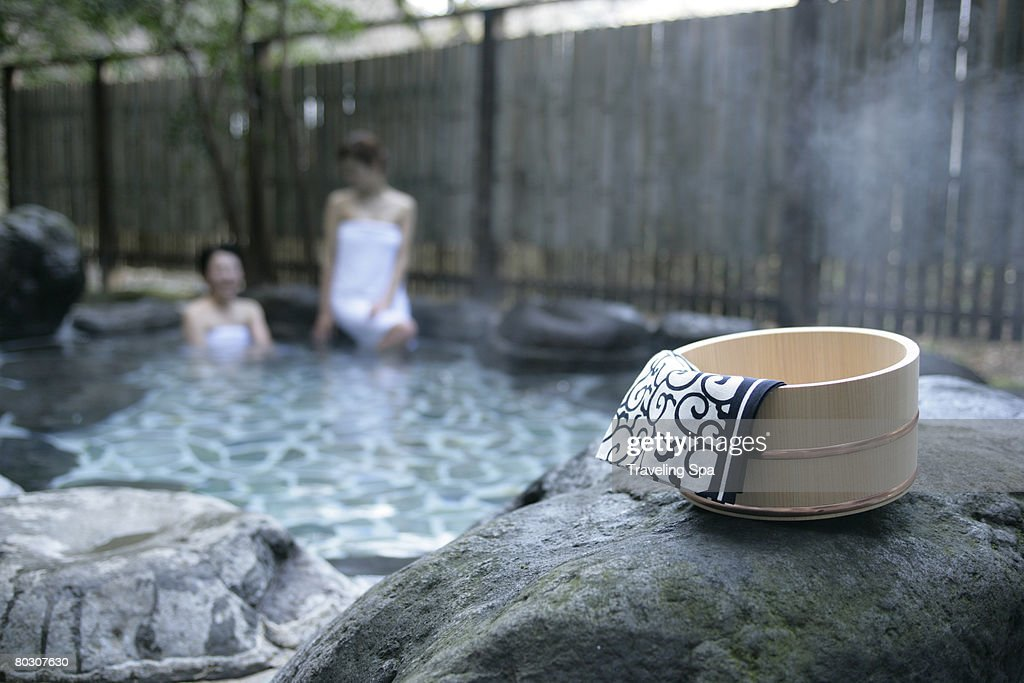 Two women soaking in hot spring : Stock Photo