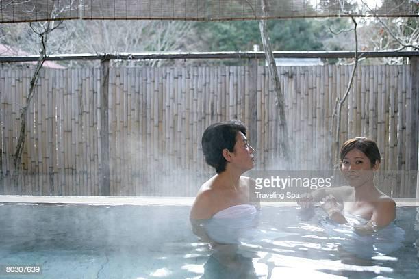 Two women soaking in hot tub