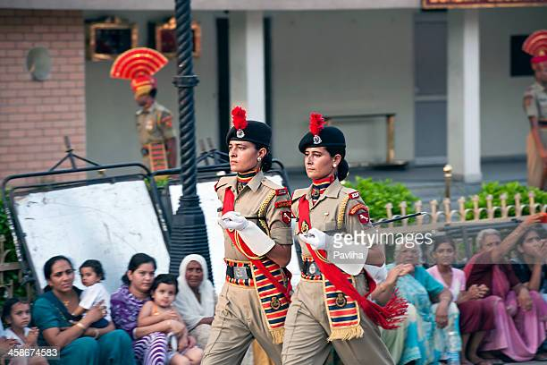 two women soldiers marching india-pakistani border - indian military stock photos and pictures
