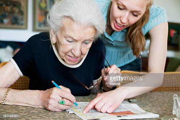 two women solving crosswords together - doing a favor stock pictures, royalty-free photos & images