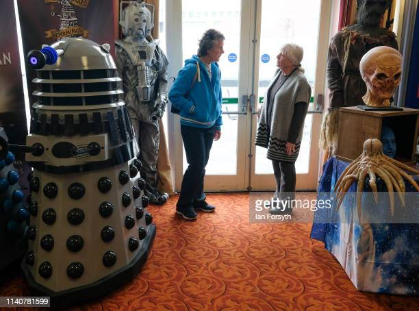 Two women speak as they stand next to a display of Darlek's on the first day of the Scarborough Sci-Fi weekend at the seafront Spa Complex on April...