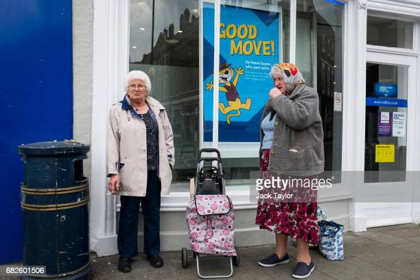 Two women stand and talk in front of a bank in the town centre on May 12 2017 in Boston United Kingdom The town of Boston in Lincolnshire voted with...