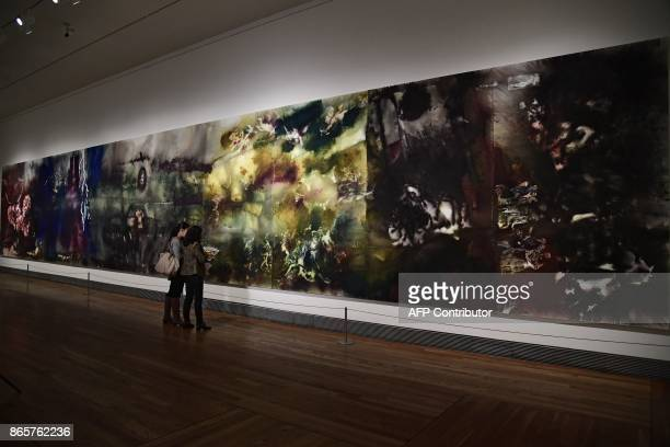 Two women stand in front of The Spirit of Painting by Chinese artist Cai GuoQiang during the presentation of his exhibition The Spirit of Painting at...