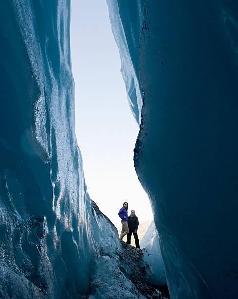 Two Women Stand Looking Into Crevasse At Worthington Glacier, Alaska, USA Wall Art