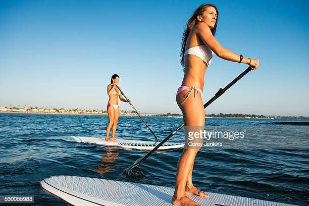 Two women stand up paddleboarding, Mission Bay, San Diego, California, USA