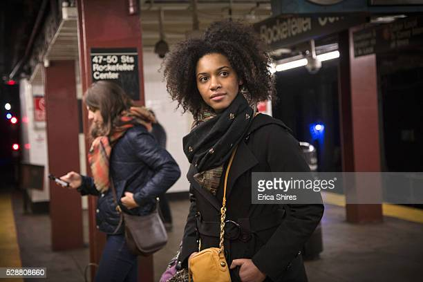 two women standing at subway station - subway platform stock pictures, royalty-free photos & images