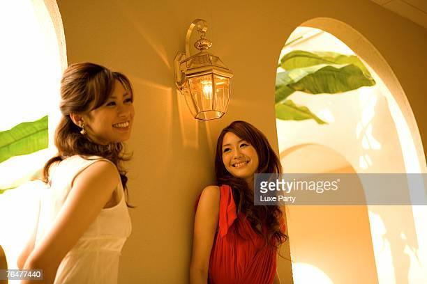 Two women standing by corridor