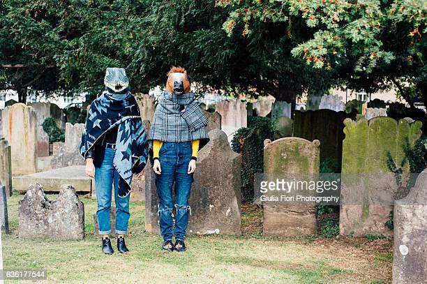 Two women standing in a graveyard