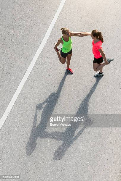two women streching and preparing for running