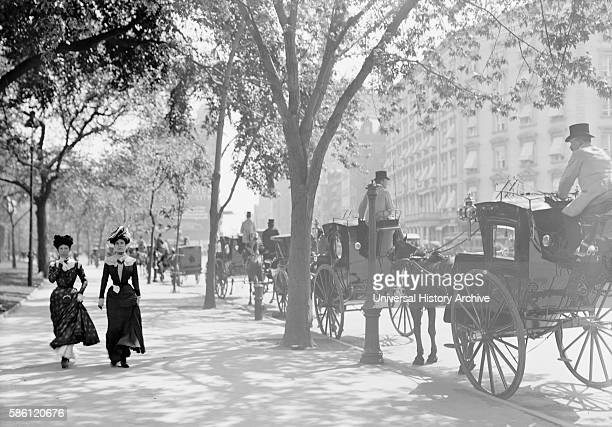 Two Women Strolling Near Cab Stand, Madison Square, New York City, USA, circa 1900.