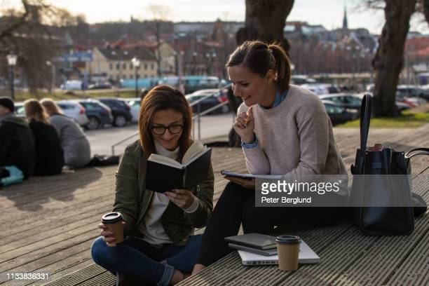 Two women studying in the city