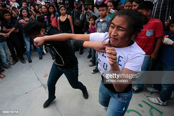 Two women take part in the traditional Xochimilcas fight to defend their women against the Aztecs in the Mexican municipality of Zitlala in Guerrero...