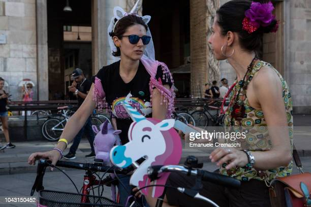 Two women take part to the Fancy Women Bike Ride on September 23 2018 in Milan Italy TheFancy Women Bike Ride is a worldwide cycling eventcombining...
