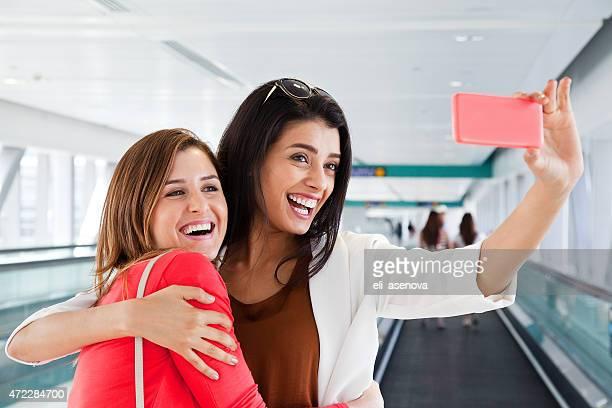 Two women take selfie in Dubai Metro