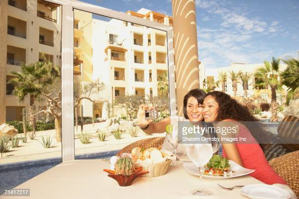 Two women taking a photograph of themselves at a resort hotel