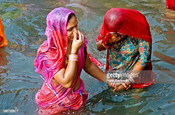 HARIDWAR UTTARANCHAL INDIA Two women taking bath at HarKiPauriGhat the famous bathingghat in Haridwar
