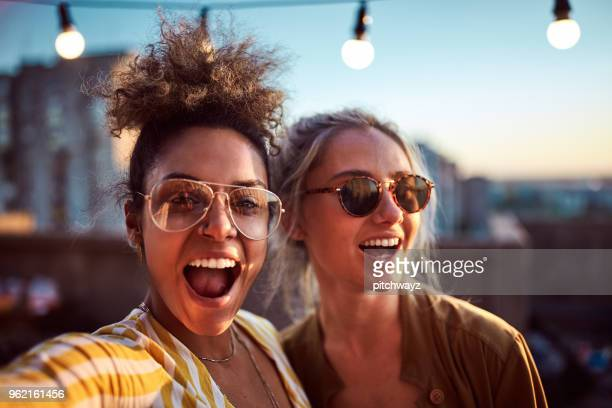 two women taking selfie at the party. - political party stock pictures, royalty-free photos & images