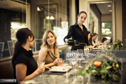 Two Women Talk At A Restaurant Table Stock Photo | Getty Images