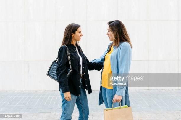 two women talking during shopping - デニムシャツ ストックフォトと画像