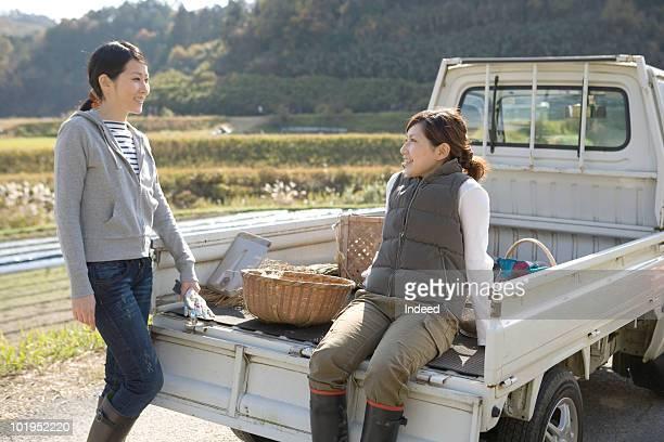 Two women talking in the field