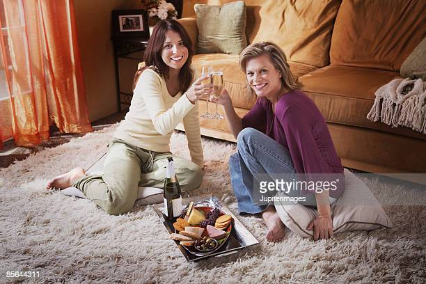 Two women toasting with champagne