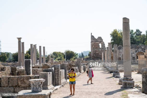 Two Women Traveler In Antique Roman City