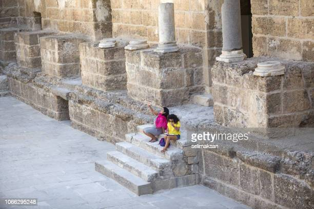 Two Women Travelers In Antique City Of Aspendos