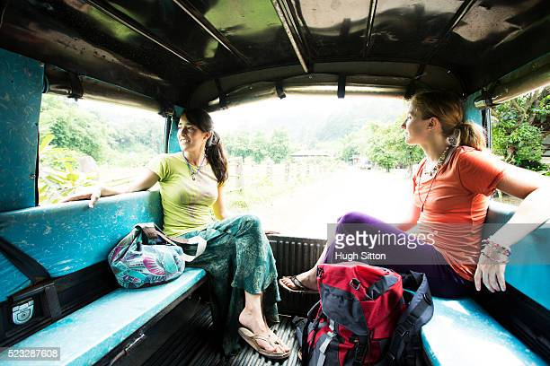 two women traveling by bus, chiang mai, thailand - hugh sitton stock pictures, royalty-free photos & images