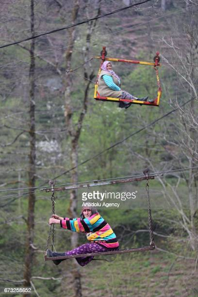 Two women use a 120 meters primitive telpher to go their home in Rize, Turkey on March 31, 2017.