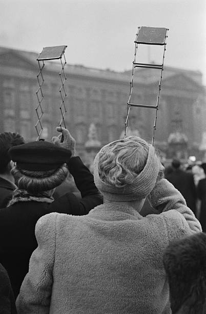 Spectators Use Periscopes